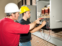 Technicians adjusting fuse box