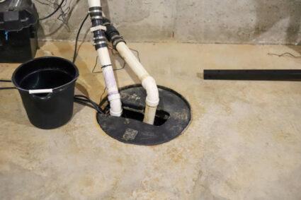 A sump pump in a home basement